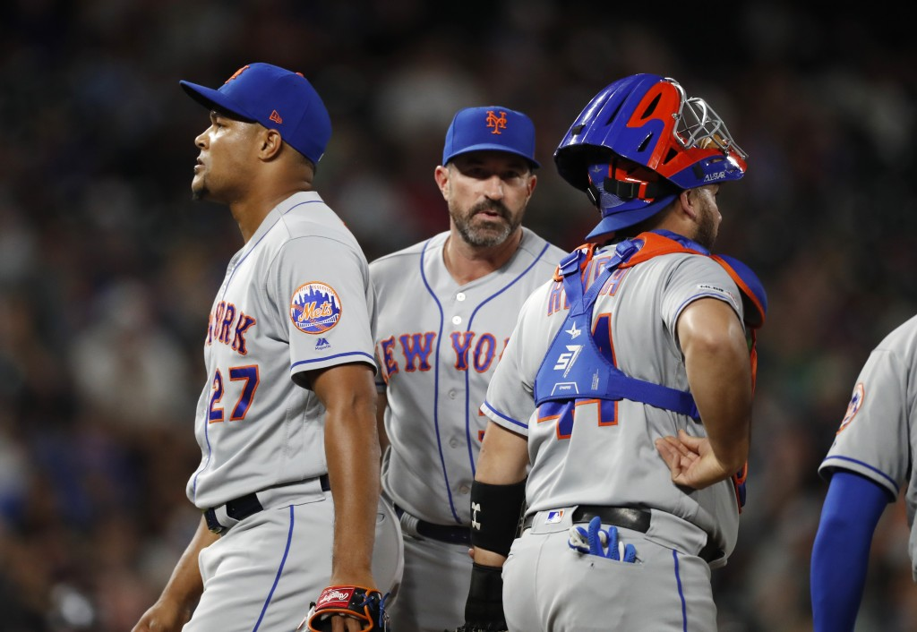 From left, New York Mets relief pitcher Jeurys Familia leaves the mound after he was pulled by manager Mickey Callaway as catcher Rene Rivera looks to