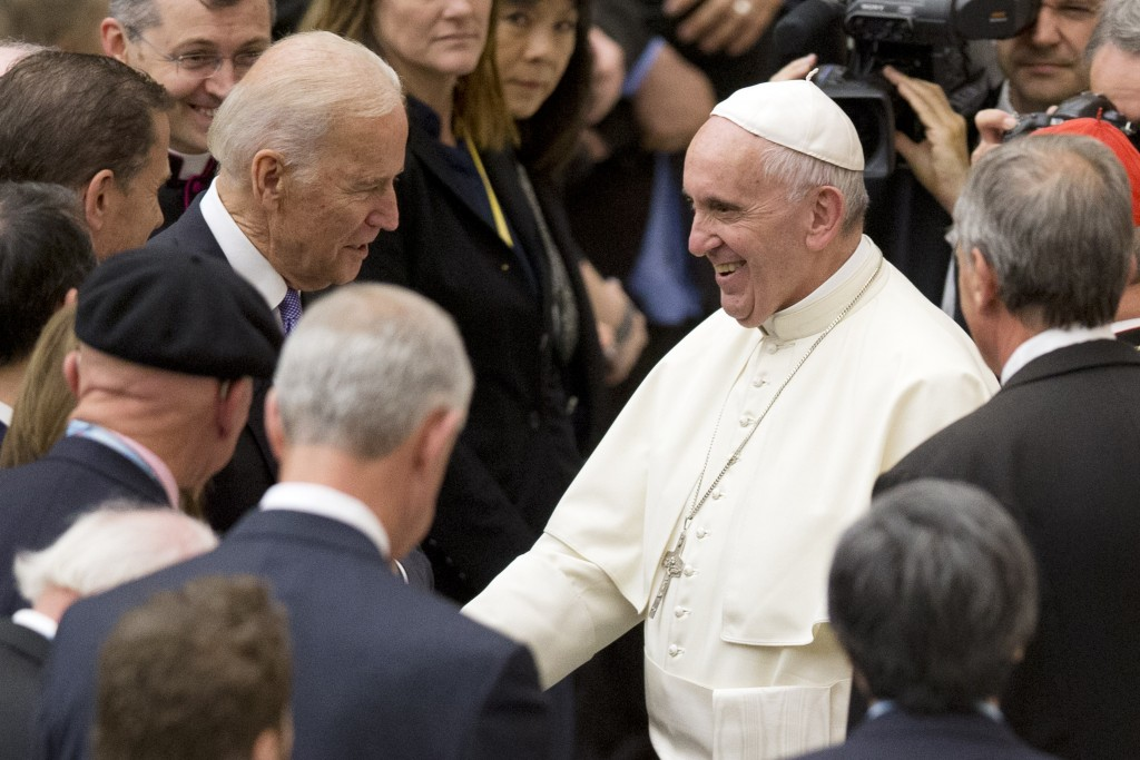 FILE - In this April 29, 2016, file photo, Vice President Joe Biden shakes hands with Pope Francis during a congress on the progress of regenerative m