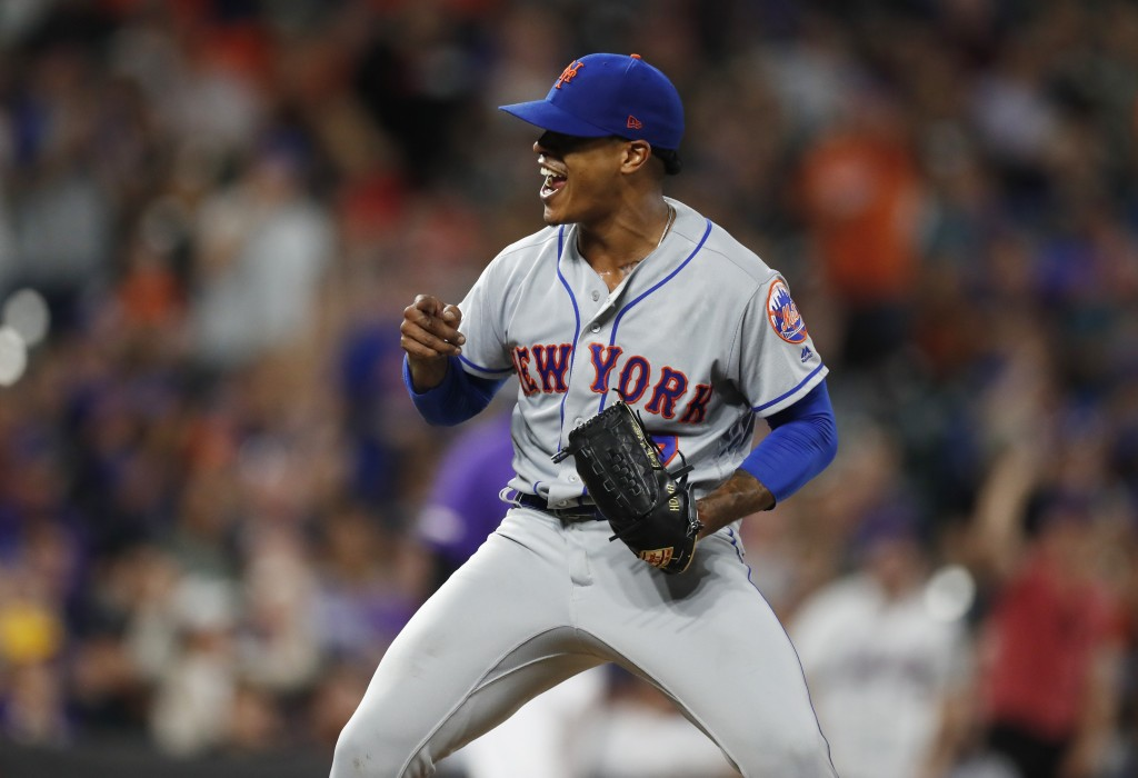 New York Mets starting pitcher Marcus Stroman reacts after catcher Wilson Ramos threw out Colorado Rockies' Charlie Blackmon, who tried to steal secon