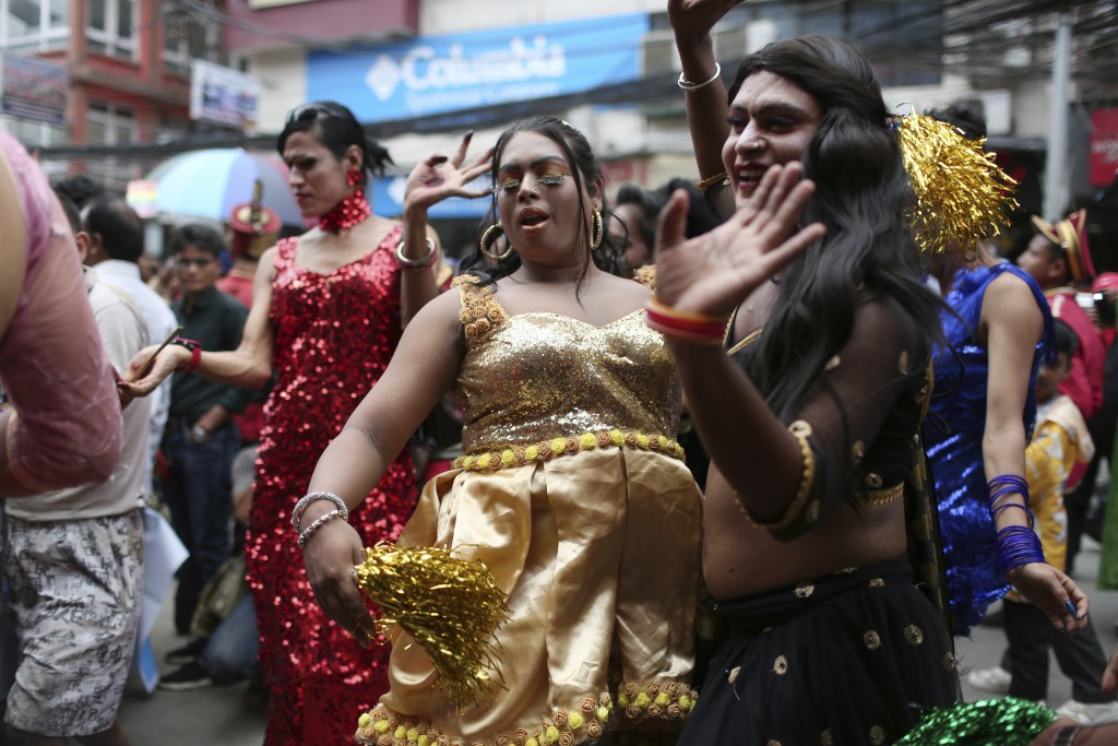 In this Aug. 16, 2019, photo, participants dance at a gay pride parade in Kathmandu, Nepal. Nepal seized the lead in equal rights for sexual minoritie...