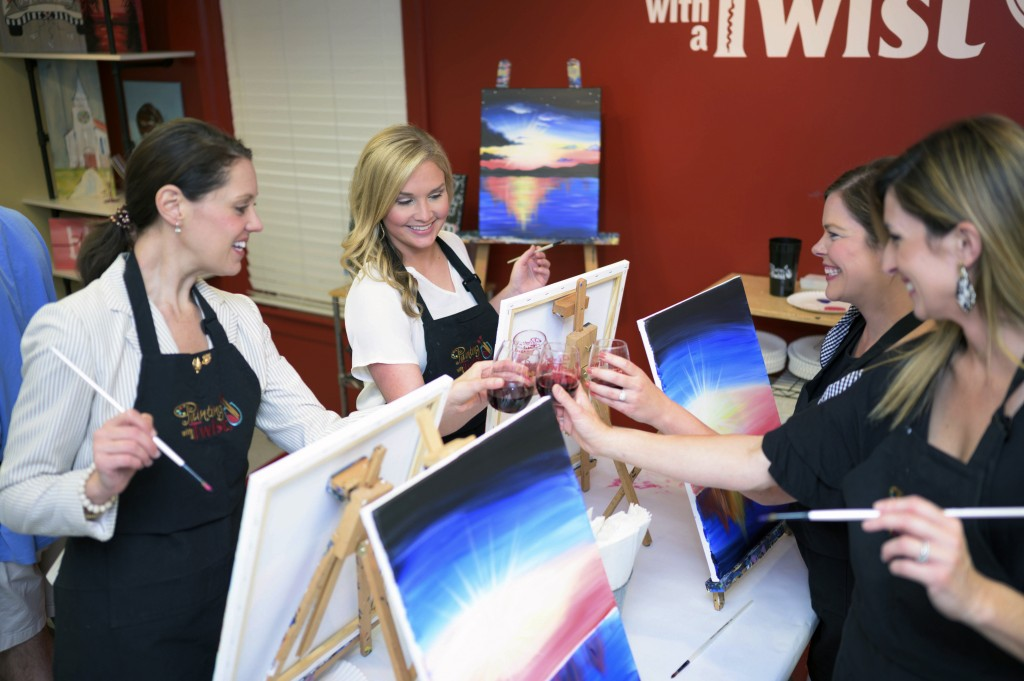 This 2019 photo provided by Painting with a Twist shows a group of women during a Painting with a Twist event in Mandeville, La. In recent years, the ...