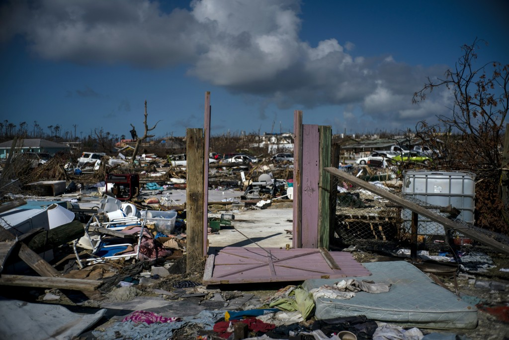 The rubble of a destroyed neighborhood stands in the aftermath of Hurricane Dorian in Abaco, Bahamas, Tuesday, Sept. 17, 2019. Dorian hit the northern...