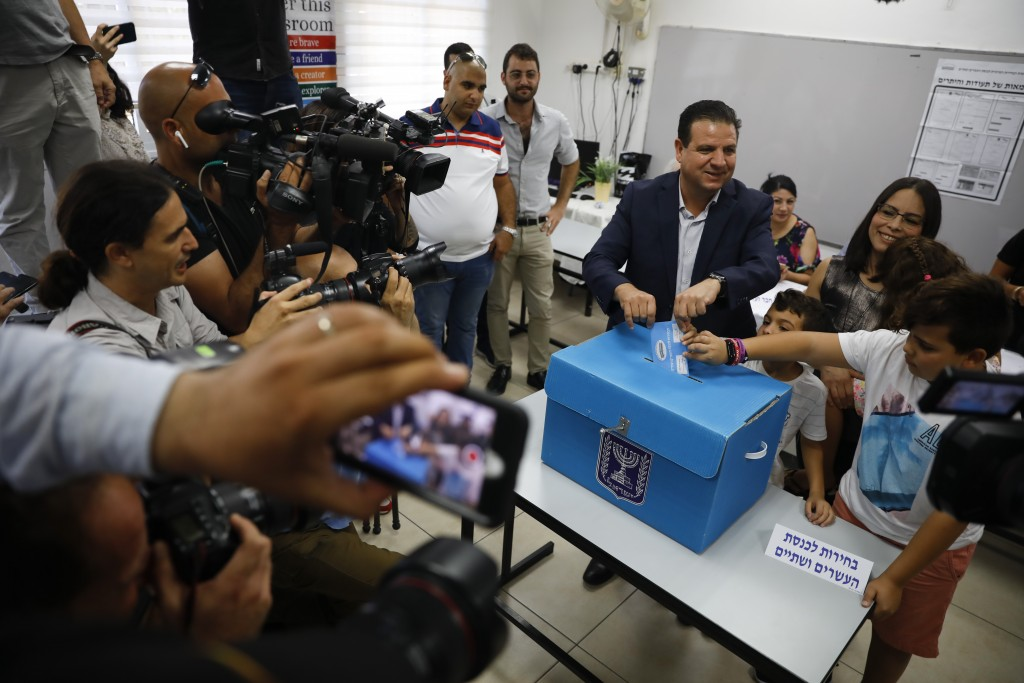 FILE - In this Tuesday, Sept. 17, 2019 file photo, Israeli Arab politician Ayman Odeh casts his vote in Haifa, Israel. Israel's Arab coalition appears