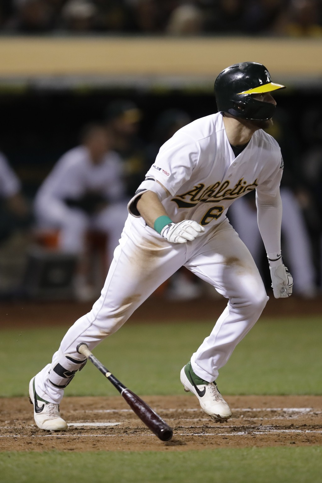 Oakland Athletics' Seth Brown drops his bat after hitting an RBI double off Kansas City Royals' Jorge Lopez during the seventh inning of a baseball ga...