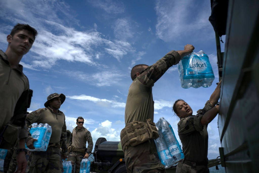 French soldiers load water to assist in the reconstruction in the aftermath of Hurricane Dorian in Abaco, Bahamas, Monday, Sept. 16, 2019. Dorian hit ...