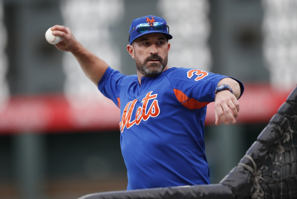 New York Mets manager Mickey Callaway throws batting practice before the team's baseball game against the Colorado Rockies on Tuesday, Sept. 17, 2019,...