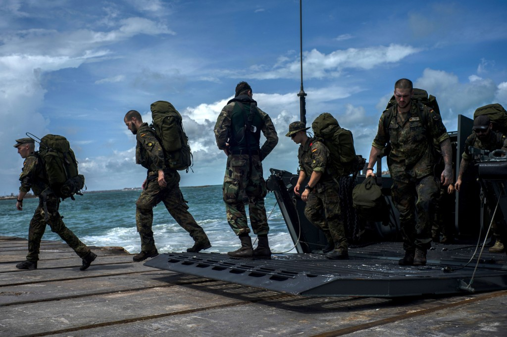 German soldiers disembark at the port to assist in the reconstruction in the aftermath of Hurricane Dorian in Abaco, Bahamas, Monday, Sept. 16, 2019. ...