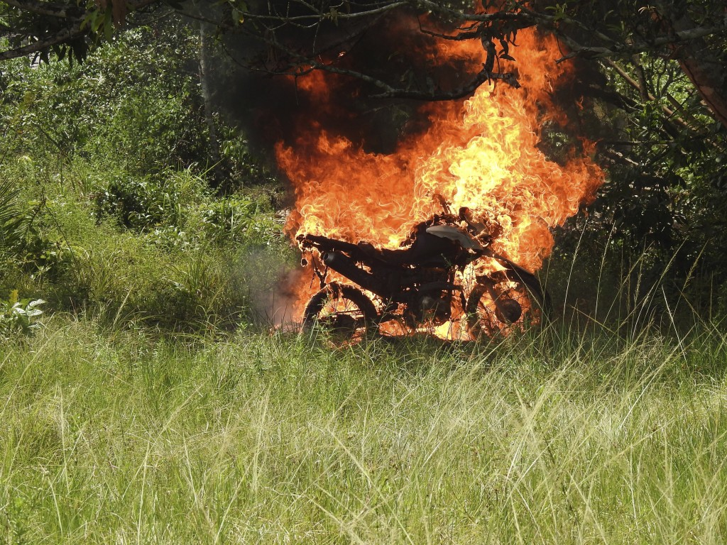In this image courtesy of Wiririhu Tembe, a motorcycle that belonged to illegal loggers burns after it was set fire by Tembe indigenous people on the ...