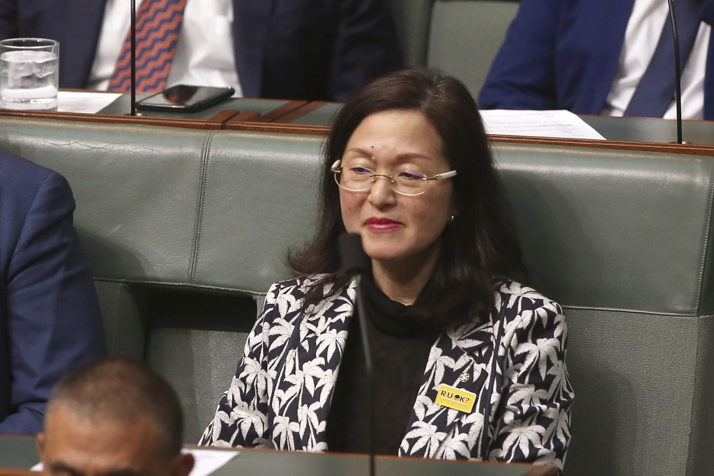 In this Sept. 12, 2019, photo, government lawmaker Gladys Liu sits in Parliament House in Canberra, Australia. Lawyers for Liu, the first Chinese-born