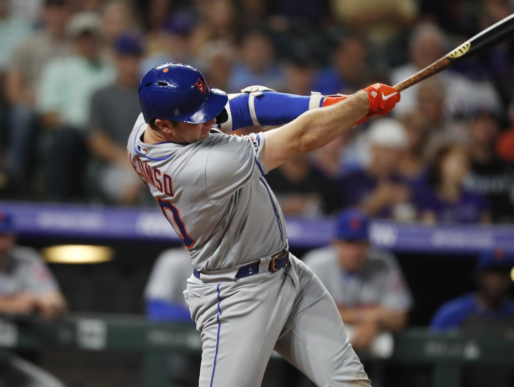 New York Mets' Pete Alonso follows through on a solo home run off Colorado Rockies pitcher Tim Melville during the sixth inning of a baseball game Tue
