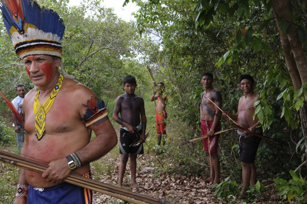 Sergio Muxi Tembe, chief of the Tekohaw village, stands with members of his tribe as they wait for police to arrive on the Alto Rio Guama indigenous r...