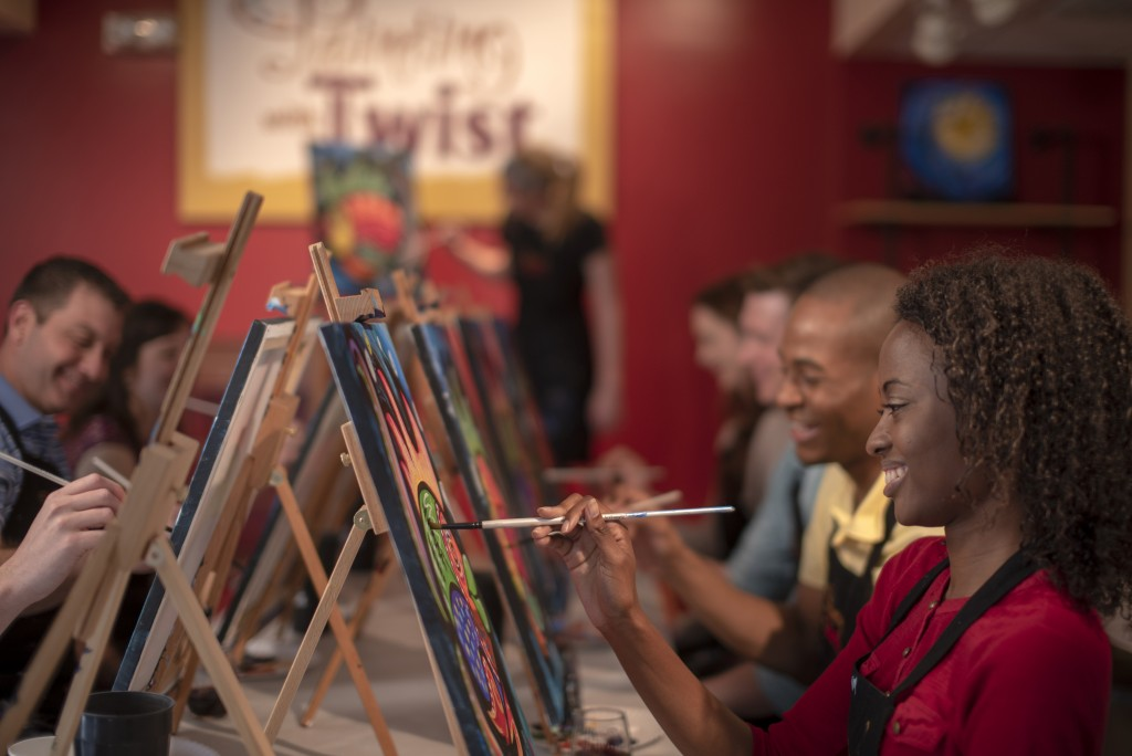 This 2019 photo provided by Painting with a Twist shows a group taking part in a Painting with a Twist event in Mandeville, La. In recent years, the i...
