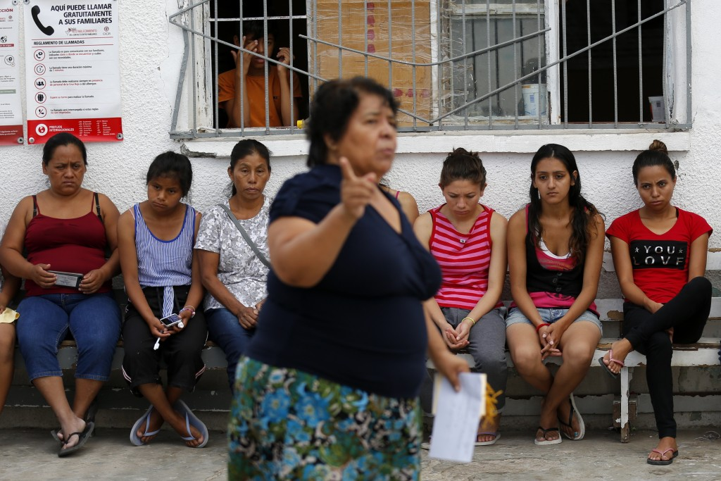 In this July 29, 2019, photo, Marta Alicia Esquivel, a volunteer at El Buen Pastor shelter for migrants, center, scolds a group of migrant mothers abo