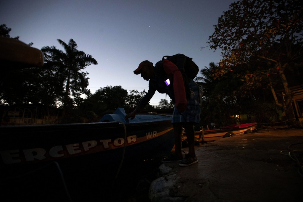 "White River Fish Sanctuary warden Lipton Bailey prepares to head out on a patrol in White River, Jamaica, Tuesday, Feb. 12, 2019. ""We are looking for ..."