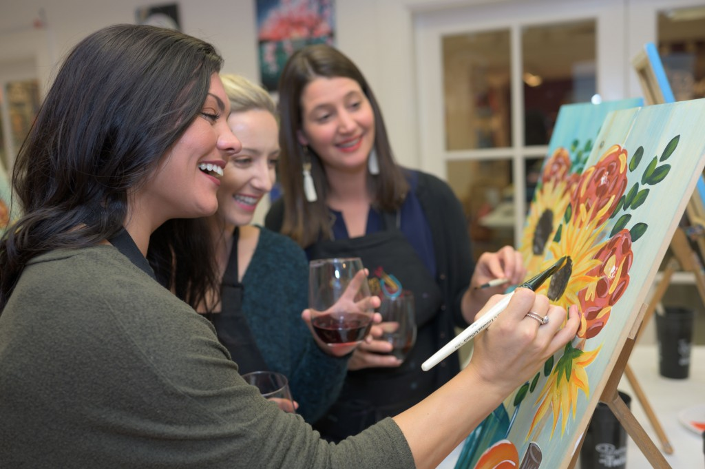 This 2019 photo provided by Painting with a Twist shows a group during a Painting with a Twist event in Mandeville, La. In recent years, the interacti