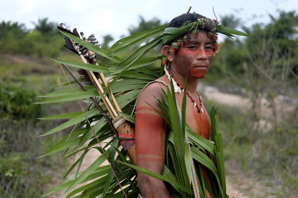 Indigenous Tembe warrior Ronilson Tembe poses for a portrait on the Alto Rio Guama indigenous reserve as he waits for police to arrive with other memb...