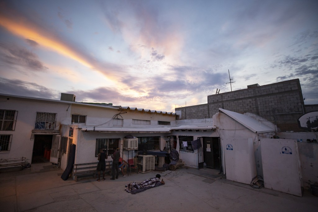 In this July 27, 2019, photo, a migrant wakes up before sunrise at El Buen Pastor shelter for migrants in Cuidad Juarez, Mexico. (AP Photo/Gregory Bul...