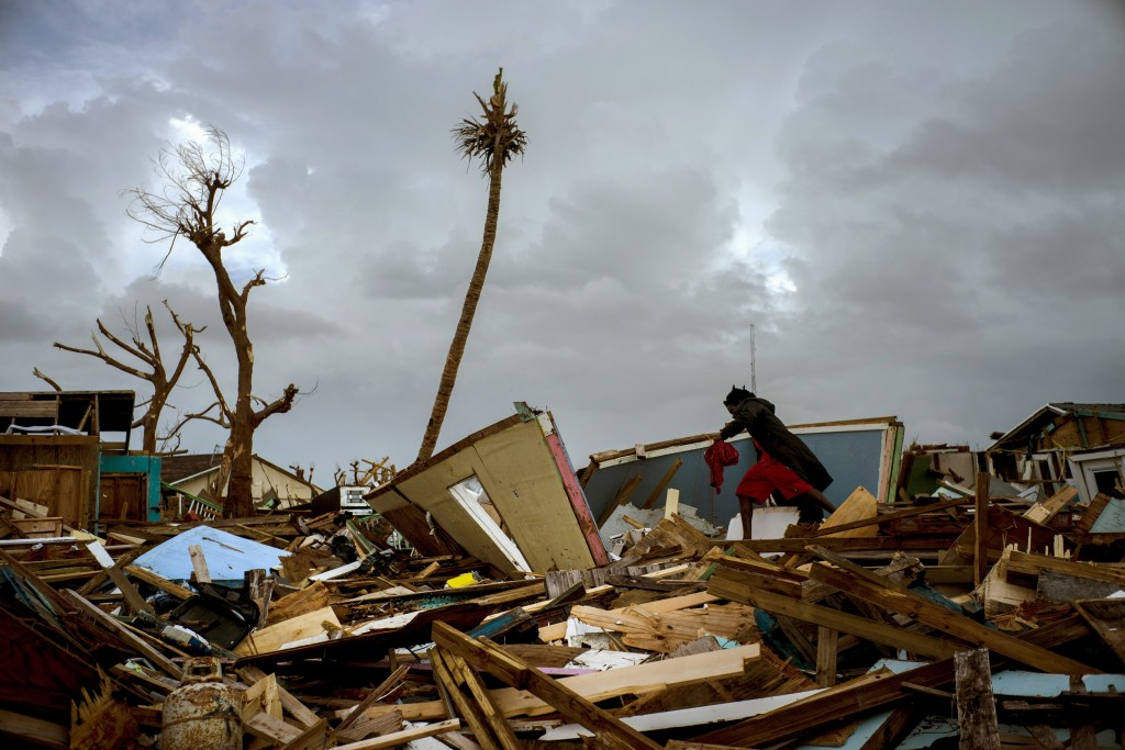 Vladimir Safford an immigrant from Haiti walks through the rubble next to his home in the aftermath of Hurricane Dorian in Abaco, Bahamas, Monday, Sep...