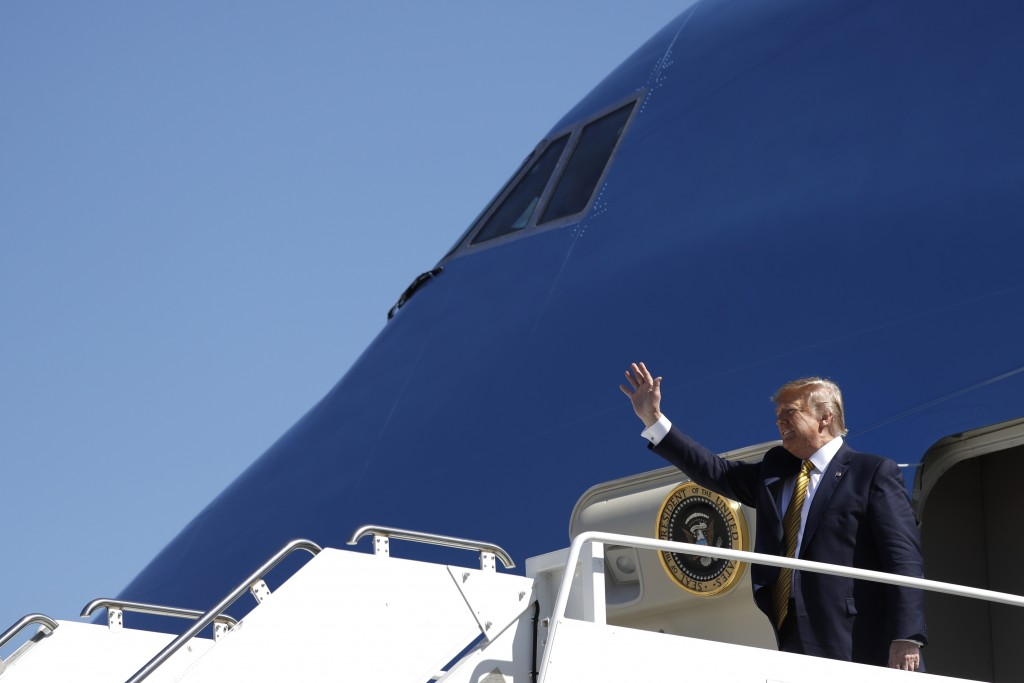 President Donald Trump arrives at Moffett Federal Airfield to attend a fundraiser, Tuesday, Sept. 17, 2019, in Mountain View, Calif. (AP Photo/Evan Vu...