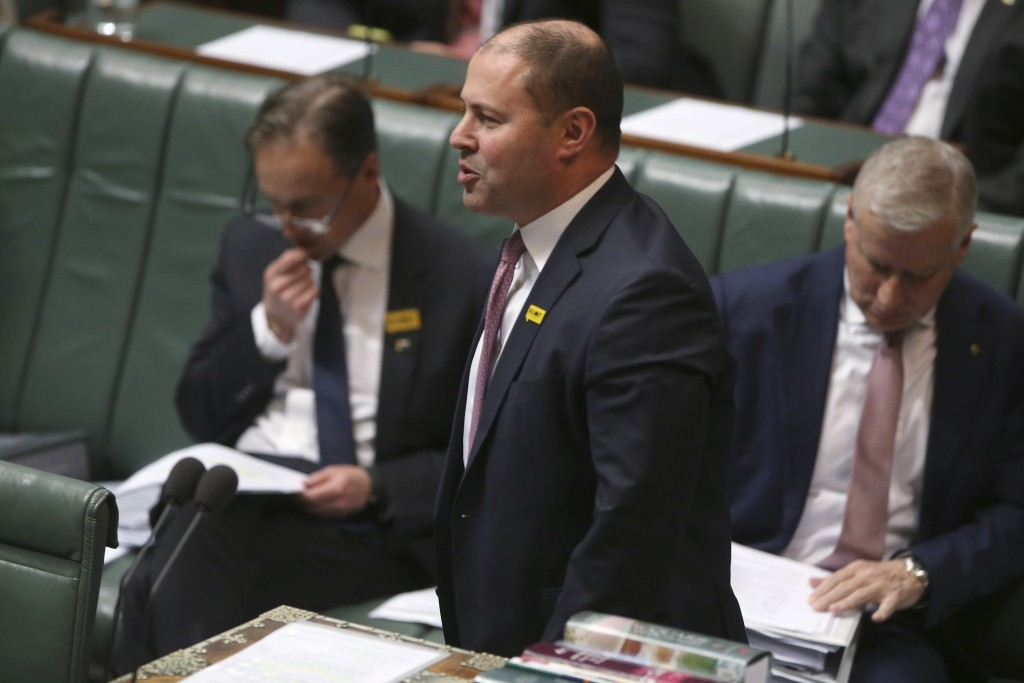 In this Sept. 12, 2019, photo, Australian Treasurer Josh Frydenberg addresses Parliament in Canberra, Australia. Lawyers for Frydenberg and for Gladys...