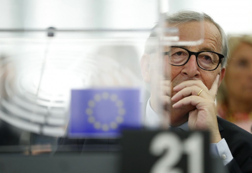 European Commission President Jean-Claude Juncker listens Wednesday, Sept. 18, 2019 in Strasbourg, eastern France, as members of the European Parliame