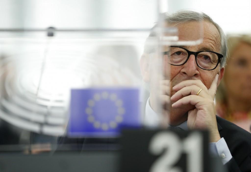 European Commission President Jean-Claude Juncker listens Wednesday, Sept. 18, 2019 in Strasbourg, eastern France, as members of the European Parliame...