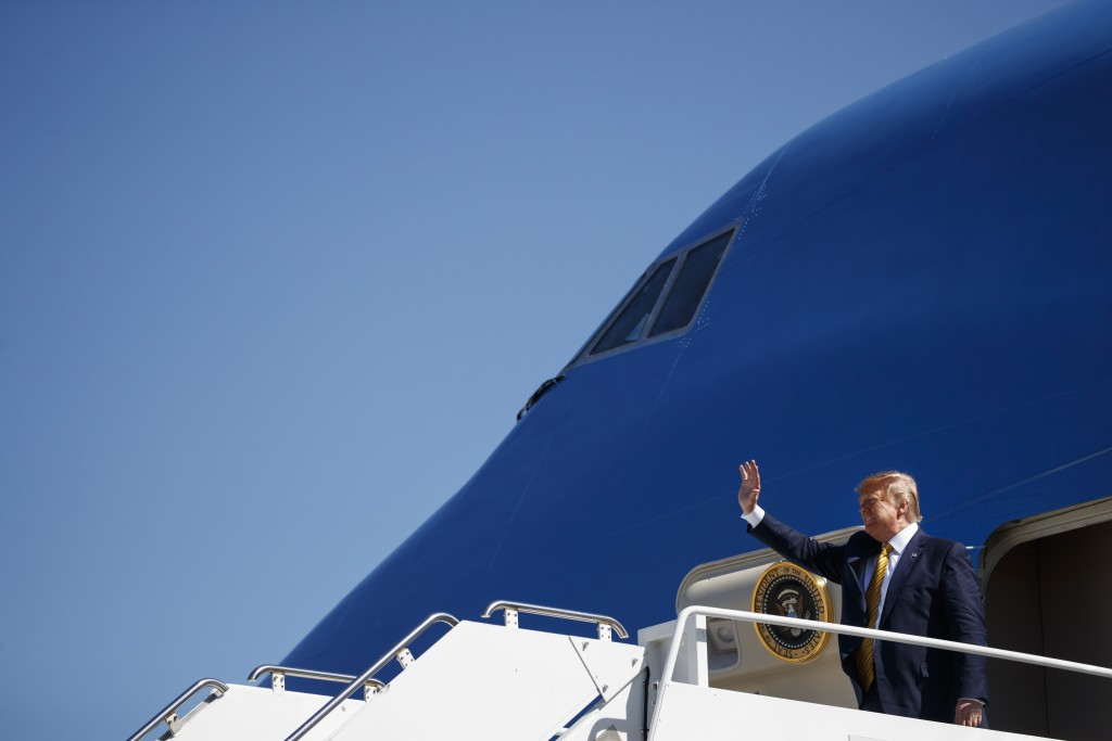 President Donald Trump waves as he arrives at Moffett Federal Airfield to attend a fundraiser, Tuesday, Sept. 17, 2019, in Mountain View, Calif. (AP P...