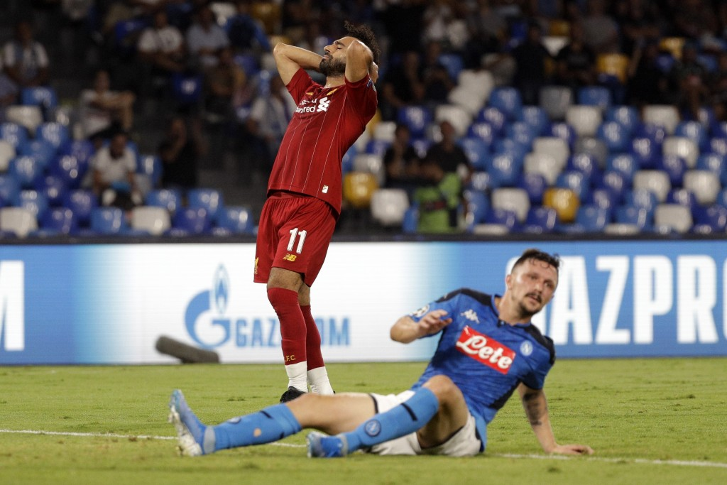 Liverpool's Mohamed Salah reacts during the Champions League Group E soccer match between Napoli and Liverpool, at the San Paolo stadium in Naples, It...
