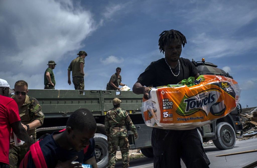 Locals receive help from Dutch soldiers in the aftermath of Hurricane Dorian in Abaco, Bahamas, Monday, Sept. 16, 2019. Dorian hit the northern Bahama...