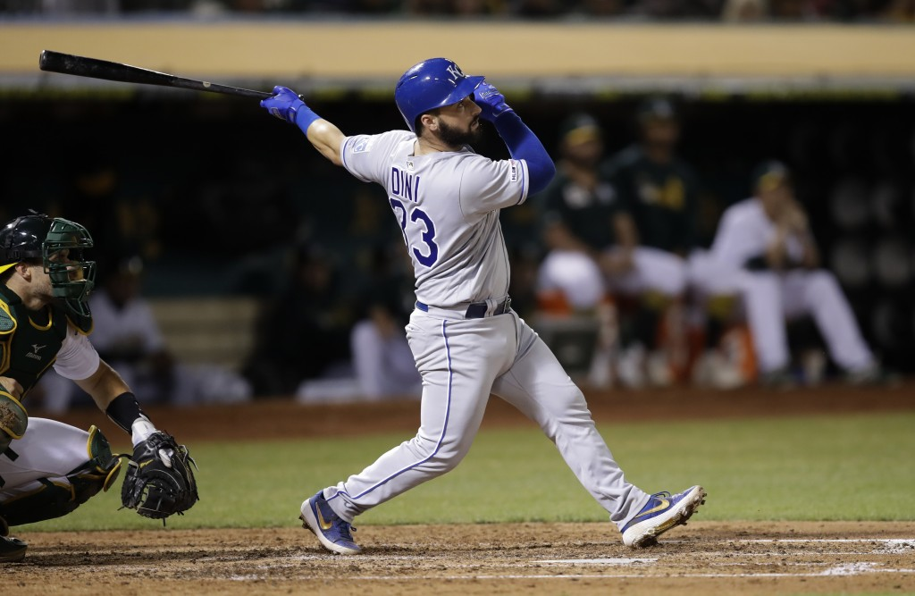 Kansas City Royals' Nick Dini watches his RBI sacrifice fly off Oakland Athletics' Brett Anderson during the fifth inning of a baseball game Tuesday, ...