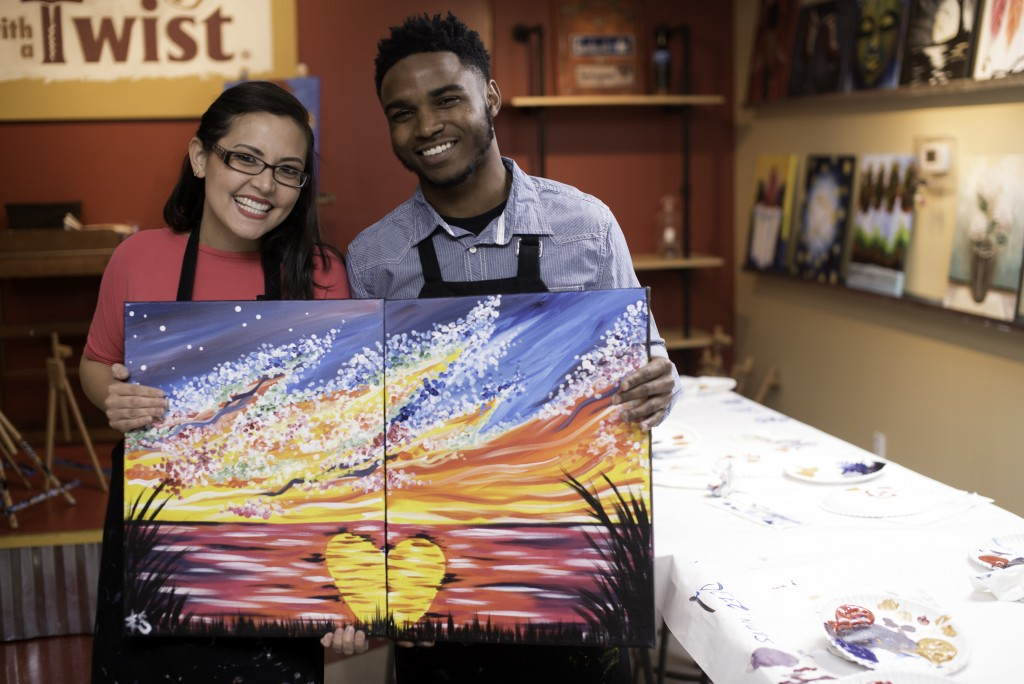 In this 2019 photo provided by Painting with a Twist, a couple reveals their date night art that when combined creates one piece of artwork they can d...