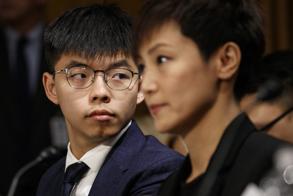 Hong Kong activists Joshua Wong, left, and Denise Ho, attend a Congressional Executive Commission on China (CECC) hearing to examine developments in H...