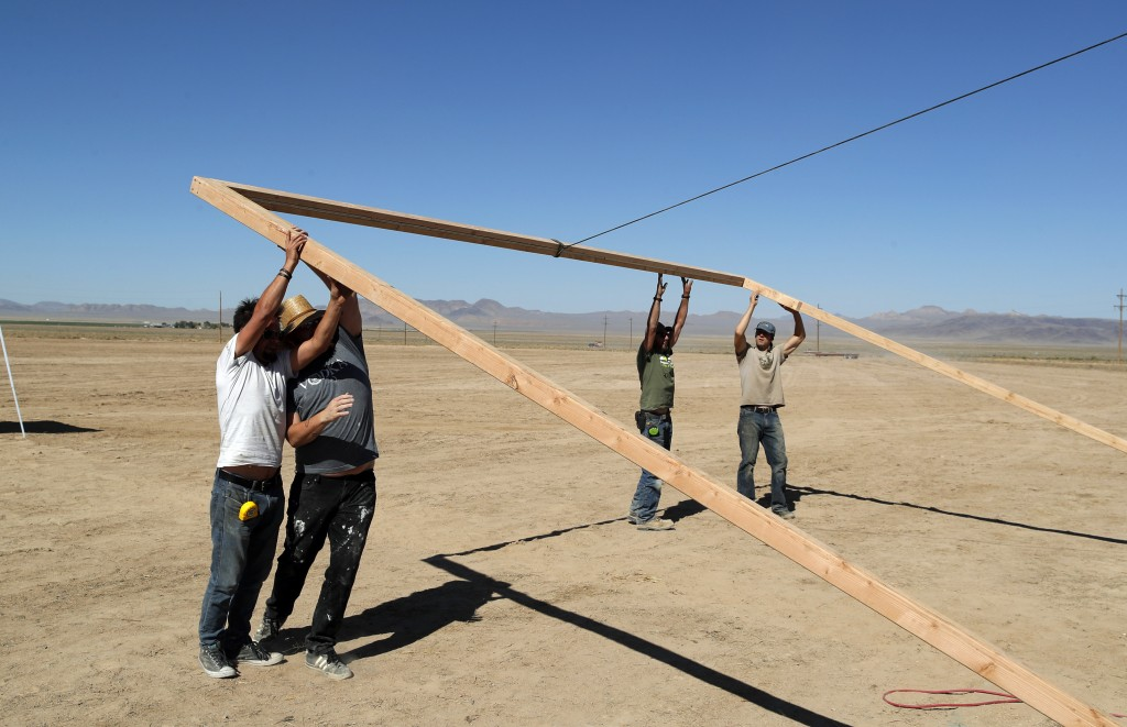 Workers erect a stage at the Little A'Le'Inn on Wednesday, Sept. 18, 2019, in Rachel, Nev. No one knows what to expect, but lots of people are prepari...