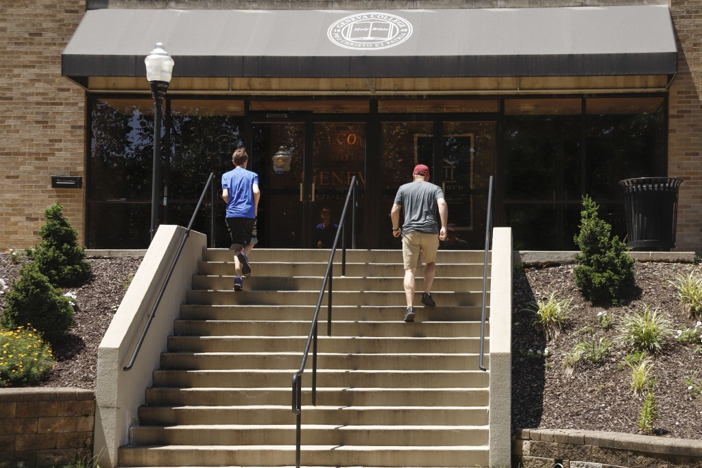In this July 13, 2019, photo visitors walk the stairs to Alexander Hall on the campus of Geneva College in Beaver Falls, Pa. Whether it's money for bo...