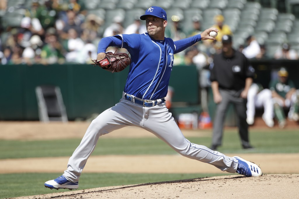 Kansas City Royals pitcher Danny Duffy throws to an Oakland Athletics batter during the second inning of a baseball game in Oakland, Calif., Wednesday...