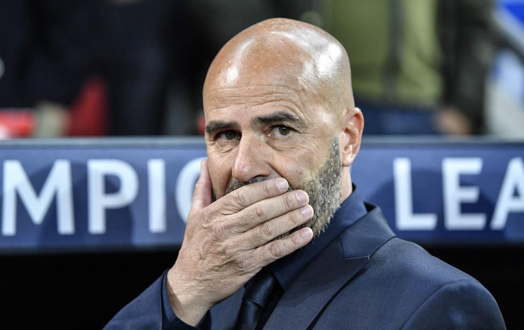 Leverkusen's head coach Peter Bosz reacts prior the Champions League Group D soccer match between Bayer Leverkusen and Lokomotiv Moscow at the BayAren...
