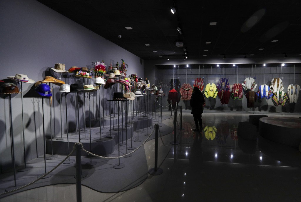 This Sept. 13, 2019 photo shows a collection of hats and ponchos Bolivia's President Eva Morales received as gifts, at the Democratic and Cultural Rev