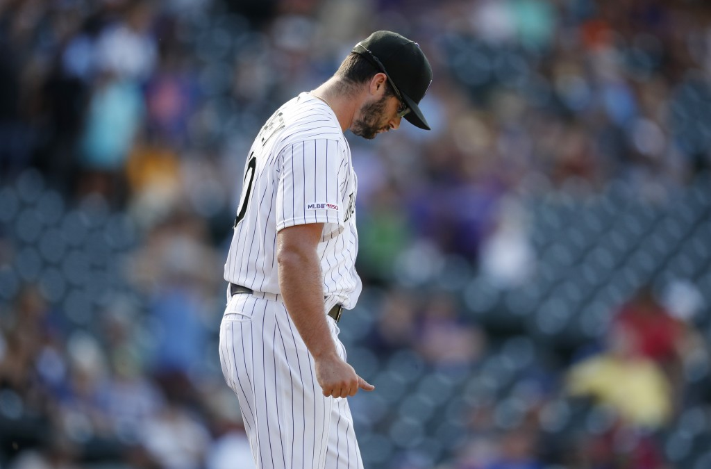 Colorado Rockies relief pitcher Joe Harvey reacts after walking New York Mets' Pete Alonso with the bases loaded to orce in the go-ahead run in the ni...