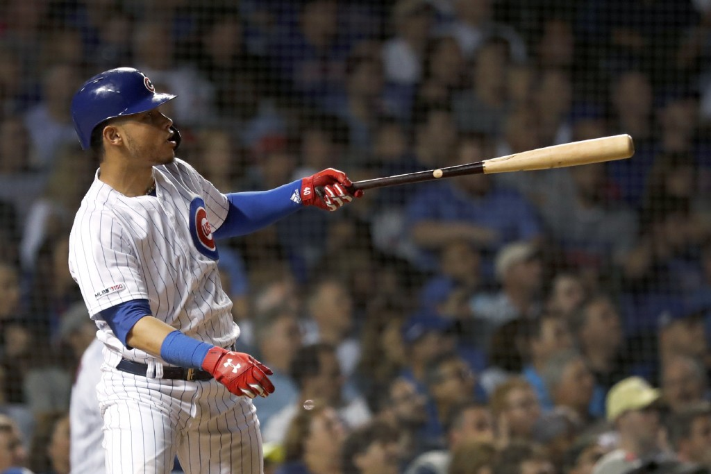 Chicago Cubs' Willson Contreras watches his home run off Cincinnati Reds relief pitcher Robert Stephenson during the seventh inning of a baseball game...
