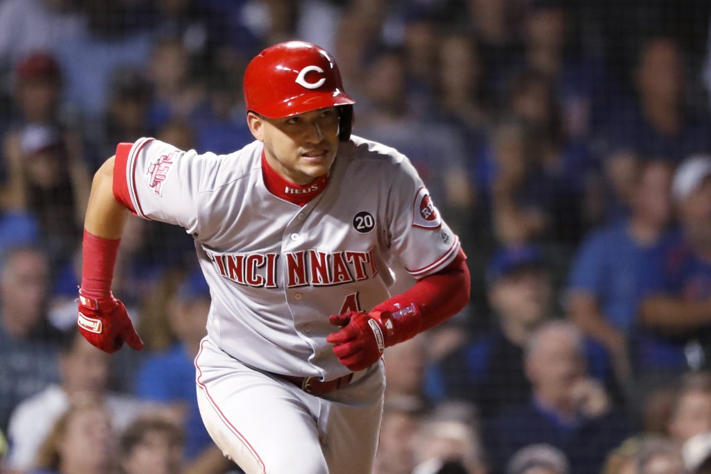 Cincinnati Reds' Jose Iglesias watches his RBI double during the 10th inning of the team's baseball game against the Chicago Cubs on Wednesday, Sept. ...