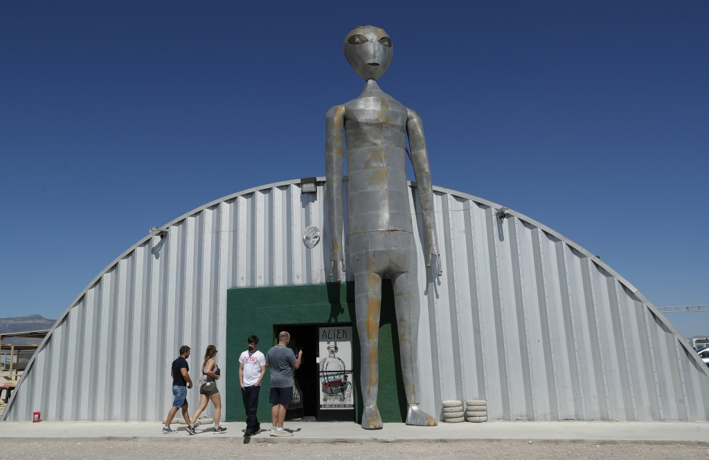 """People enter and exit the Alien Research Center in Hiko, Nev. No one knows what to expect, but lots of people are preparing for """"Storm Area 51"""" on Wed..."""