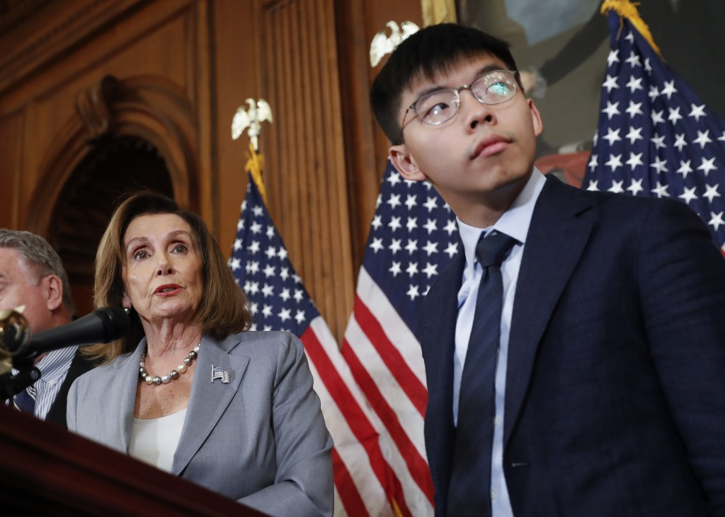 House Speaker Nancy Pelosi, left, with Hong Kong activist Joshua Wong and other members of Congress during a news conference on human right in Hong Ko...
