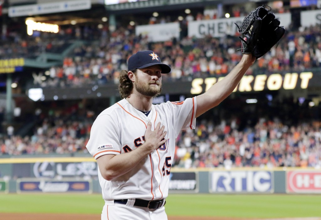 Houston Astros starting pitcher Gerrit Cole waves to the crowd as he leaves the mound after striking out Texas Rangers designated hitter Shin-Soo Choo