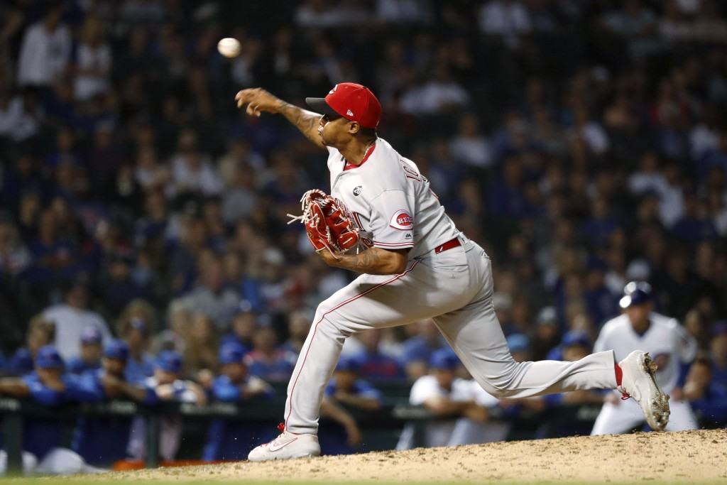 Cincinnati Reds relief pitcher Raisel Iglesias delivers during the 10th inning of the team's baseball game against the Chicago Cubs on Wednesday, Sept...
