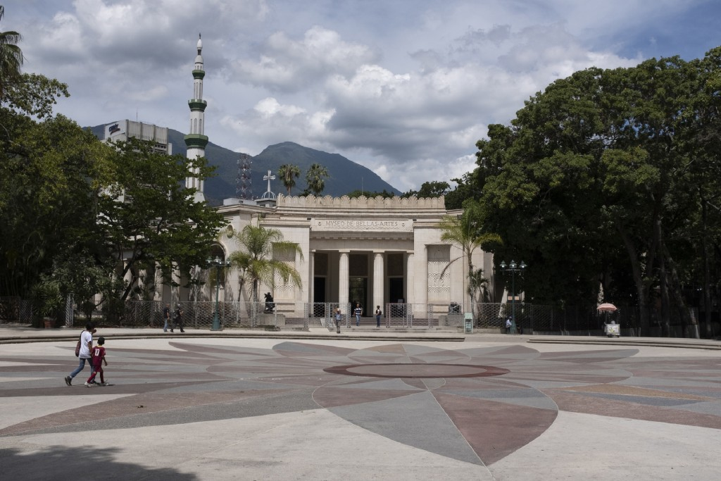 In this Sept. 17, 2019, photo, people walk in front of the Museum of Fine Arts of Caracas, Venezuela. Only about a third of the 18 galleries are open ...