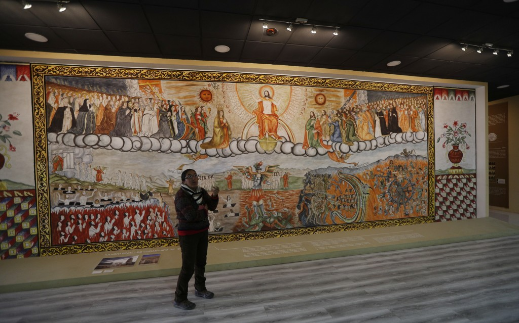 In this Sept. 13, 2019 photo, a curator at the Democratic and Cultural Revolution Museum speaks about a representation of the Curahuara de Carangas' F