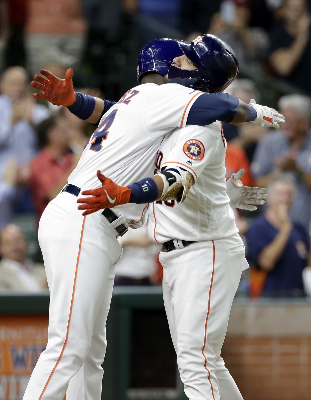 Houston Astros' Yordan Alvarez, left, and Yuli Gurriel, right, hug at home plate after they both scored on Gurriel's two-run home run during the fifth...