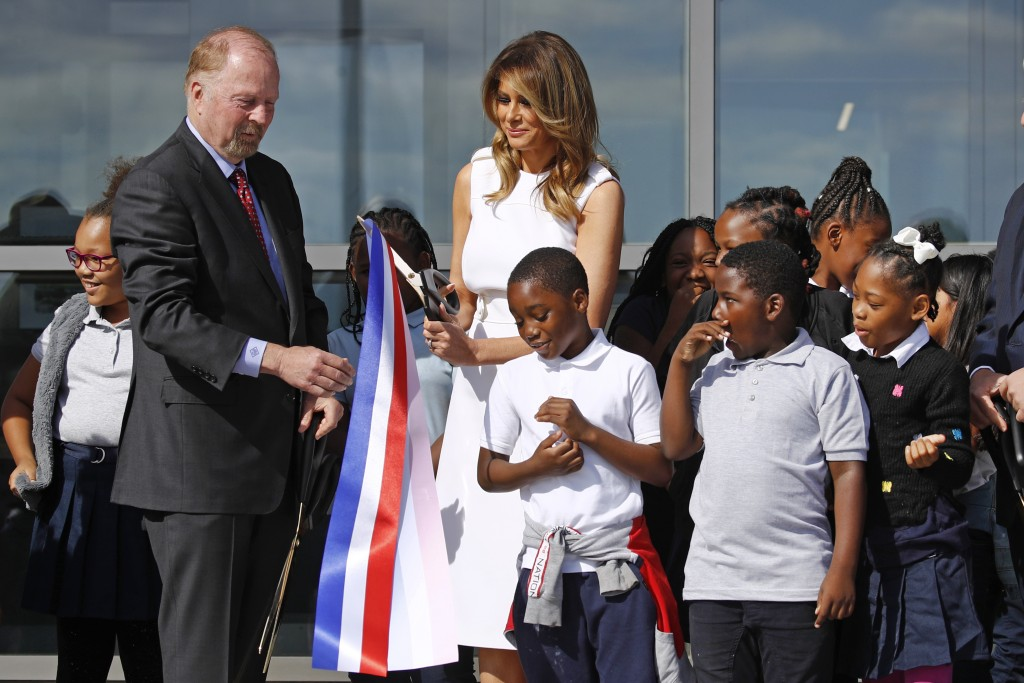 First lady Melania Trump, center, and Department of Interior assistant secretary Rob Wallace, left, participate in a ribbon-cutting ceremony with stud...