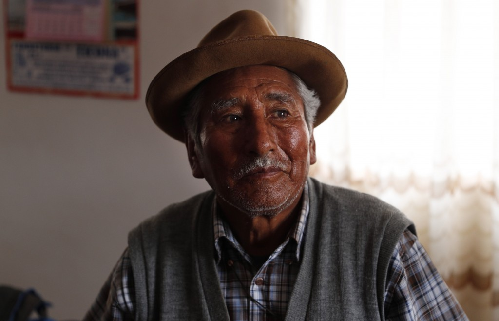 In this Sept. 13, 2019 photo, retired school teacher Gerardo Villca, a cousin of Bolivia's President Evo Morales, pauses during an interview in Orinoc