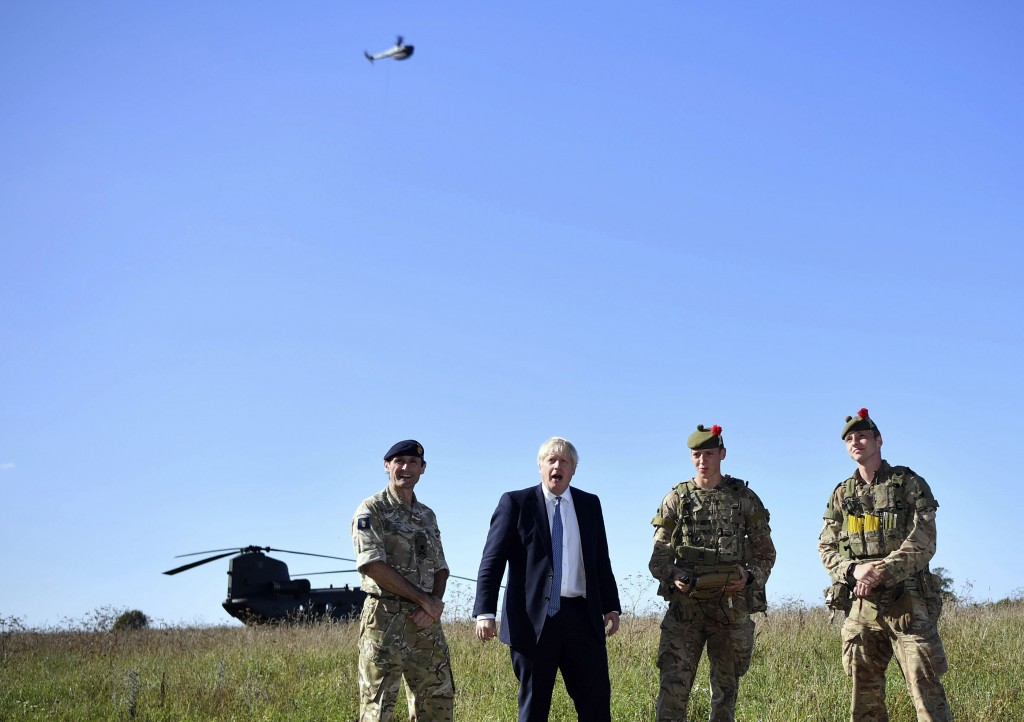Britain's Prime Minister Boris Johnson flies a Black Hornet nano drone as he meets with military personnel on Salisbury Plain training area near Salis
